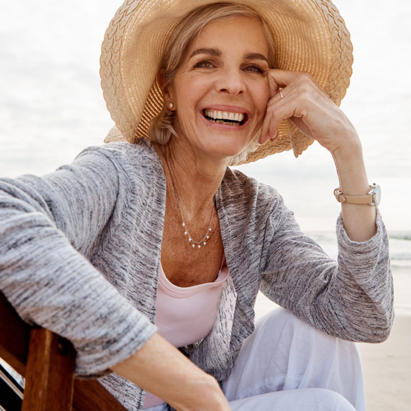 senior woman smiling on beach