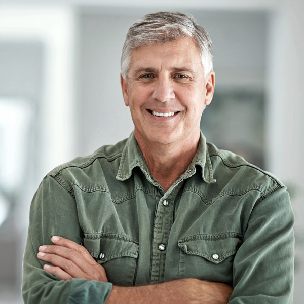 man in green shirt smiling
